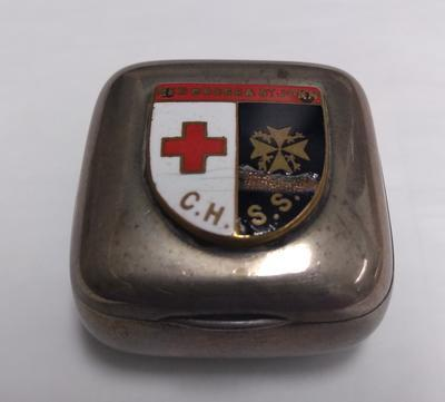 Small silver plate box with Central Hospital Supply Service badge