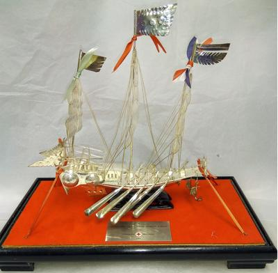 Silver model of a boat in a presentation box gifted by the Hong Kong Red Cross