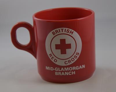 Red plastic 'British Red Cross Mid Glamorgan Branch' mug
