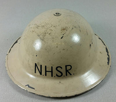 White hard hat featuring the letters ' N.H.S.R' to front and back, with soft leather interior and green chin strap