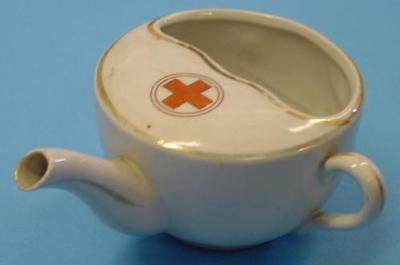 china feeding cup with spout and handle, decorated with gold around edges, white cross in a red circle on top