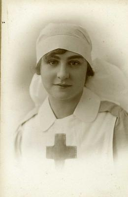 Laminated reproduction of a portrait photograph of nurse Florence Baker, 1919