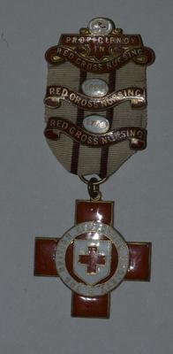 Proficiency badge in Red Cross Nursing with 1932 and 1933 bar