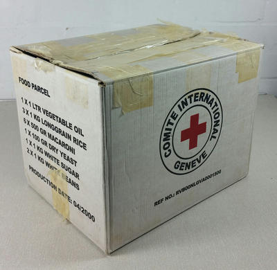 Food Parcel packaging. White cardboard box with the words 'Comite International Geneve' around a red cross, on the front and back and a list of contents on the sides.