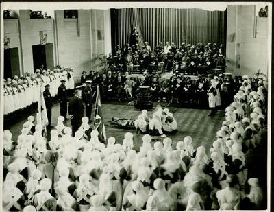photograph of a first aid demonstration which is taking part in a large hall