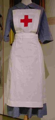 Replica Member's indoor uniform white apron with red cross on square bib and two gold safety pins