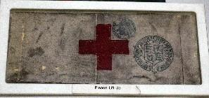 brassard featuring red cross emblem