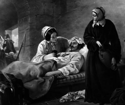 Representation of Florence Nightingale mopping the brow of a wounded soldier at Scutari Hospital