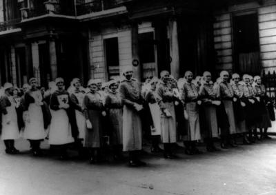 A group of personnel assembled outside British Red Cross headquarters in London
