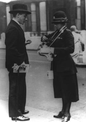 Dame Beryl Oliver selling a Red Cross lapel pin during a flag day