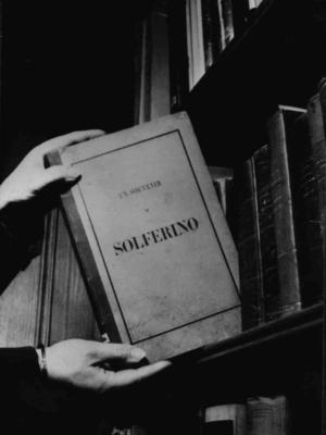 Photograph of the book 'A Memory of Solferino' by Henry Dunant
