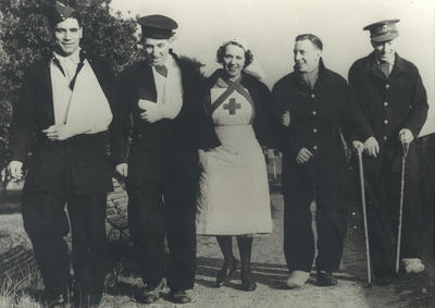 VAD walking in the grounds of a home with four convalescing servicemen