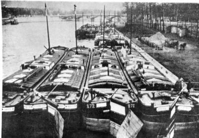 Exterior view of four river barges which were converted into hospitals