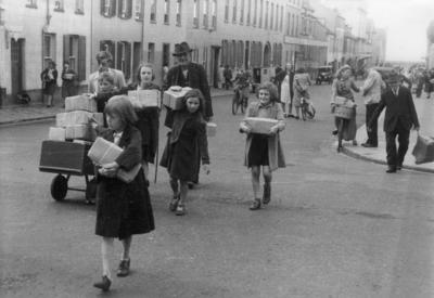 Inhabitants of the Channel Islands receiving a consignment of food parcels