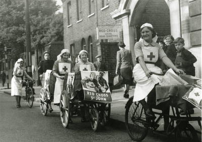 British Red Cross VADs with bicycles and tricycles outside Hammersmith Red Cross headquarters