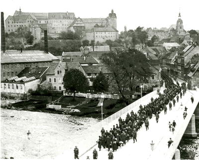Prisoners of War from Oflag IVC (Colditz) marching through town