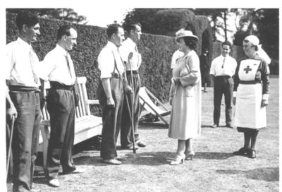 HM Queen talking to wounded soldiers at Barnett Hill convalescent home; JWO/1/4/2/IN0956