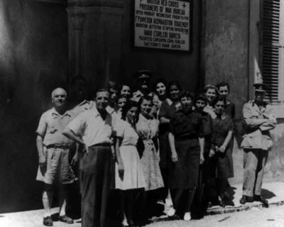 British Red Cross prisoner of war bureau in Cyprus, with staff outside.