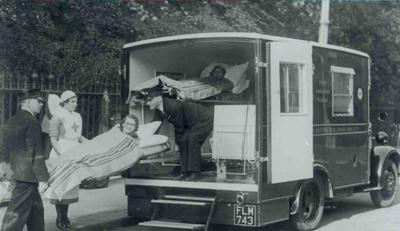 Loading patients onto a Home service ambulance