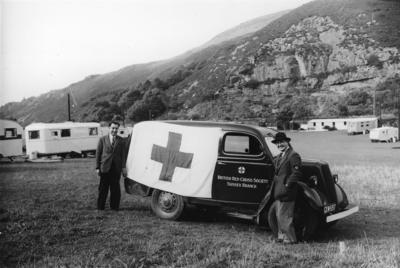 British Red Cross van distributing relief goods to caravan dwellers