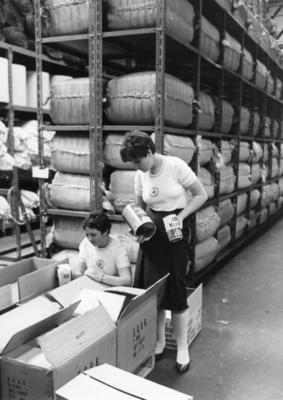 Two British Red Cross youth members packing food supplies in a store to send to Lebanon during the Appeal
