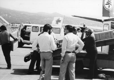 Red Cross relief supplies being unloaded from a plane at Beirut airport