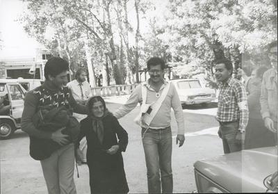 Red Cross personnel escort an elderly woman in Lebanon; RCC/5/IN1288