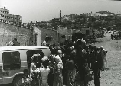 Crowd around a Red Cross vehicle in Lebanon; RCC/5/IN1295