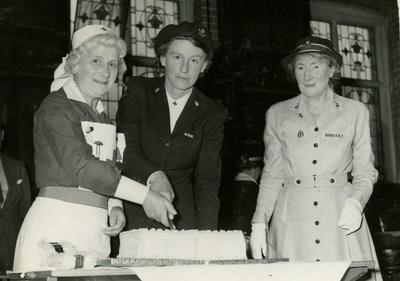 Marjorie Clay and Two other British Red Cross Officers cutting a Cake