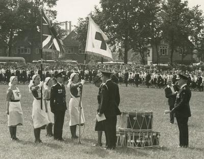 Presentation of Flag Party, Union Jack and Red Cross Flag, at the Service of Dedication of the Surrey Branch Flag by Princess Mary at Stoke Park, Guildford