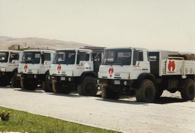 Front view of 'the simple truth' lorries with aid deliveries