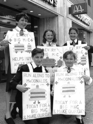Five youth members outside McDonalds wearing sandwich boards over their uniforms about a McDonalds fundraising event for Bridgewater Centre ambulance appeal