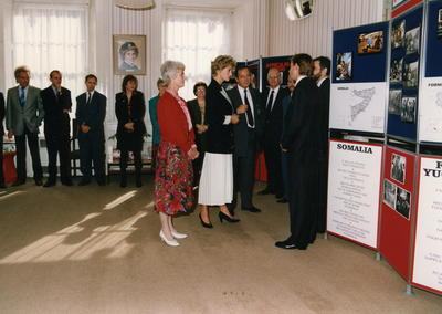Diana, Princess of Wales looks at display on international work during a visit to British Red Cross National Headquarters