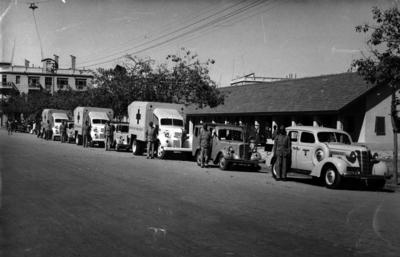 Black and white photograph. Relief to to India and Pakistan. The Ambulance and Utility Car convoy presented by the B.R.C.S. before departure to Multan. 3 February 1948.