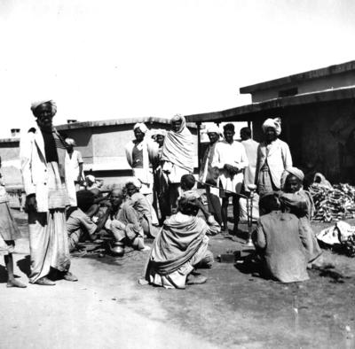 Black and white photograph. Lady Limerick's visit to India and Pakistan. Refugees cooking, Multan