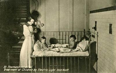 Postcard of young children receiving electric light treatment at St Thomas's Hospital