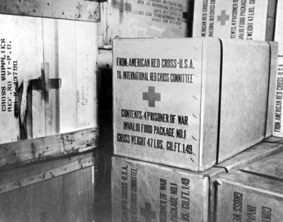 Stack of packages containing four prisoner of war invalid food parcels