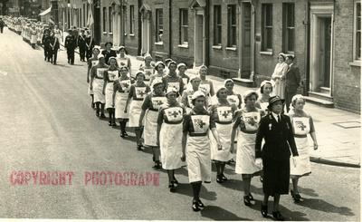 Two Groups of VADs from the Farnham Division, Surrey, marching in the Street