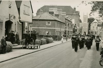 Red Cross Brass Band from the Farnham Division, Surrey, marching past a Church