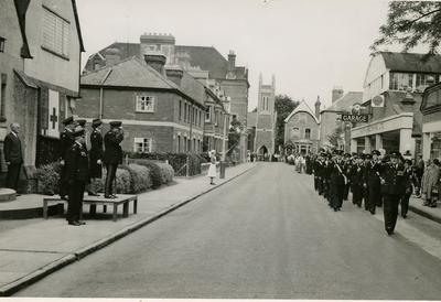 Group of Male VADs from Farnham Division, marching past a Church