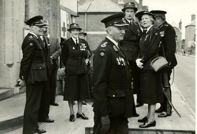 Group of Officers and Officials from the Farnham Division, Surrey, standing on a Dais outside a Church