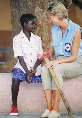 Princess Diana with a landmine victim in Angola