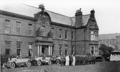 Parade of nurses, orderlies, motor cars and ambulances outside the General Military Hospital in Stobhill, Glasgow