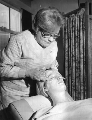 A British Red Cross member giving a beauty treatment in a hospital in Wales