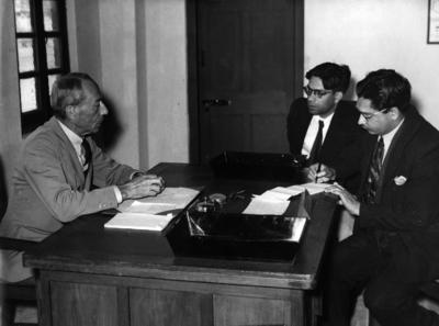 Black and white photograph. British Red Cross Commissioner during an interview with the Pakistan Government publicity officer