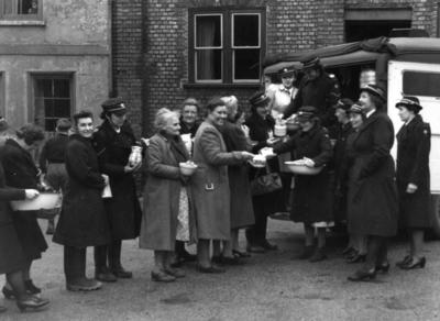 Distributing food from the Red Cross mobile canteen in St Mary Street, Gloucester following flooding; RCC/5/IN3467