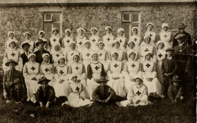 Group of VAD Nurses with Commandant, Miss Florrie Thomas, from Cornwall/40 (St Just) in Indoor Nursing Uniform