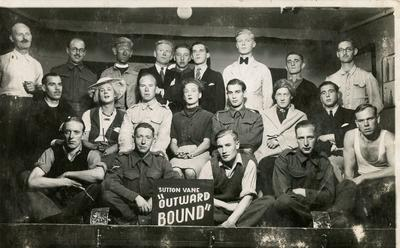 Photograph of a group of prisoners of war cast in a performance of the play 'Outward Bound' at Stalag XXIA
