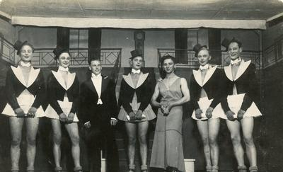 Photograph of prisoners of war partaking in a entertainment revue show at Stalag XXIA camp