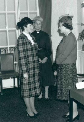 HM Queen Elizabeth II meeting a lady at national headquarters